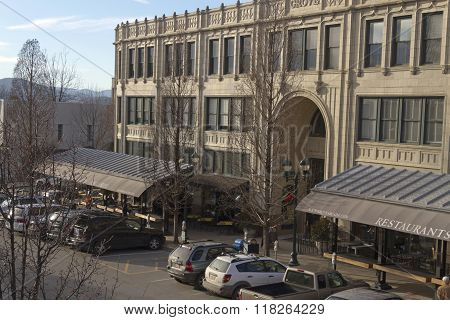 Asheville North Carolina USA - January 30 2016: View overlooking the art deco artistry of the Grove Arcade and the distant mountains in downtown Asheville on a sunny winter's day