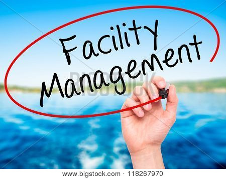 Man Hand Writing Facility Management With Black Marker On Visual Screen