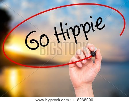 Man Hand Writing Go Hippie With Black Marker On Visual Screen