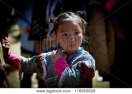 H'mong ethnic minority kid in Bac Ha traditional market in Laocai, Vietnam.