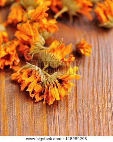 Calendula Dried Flowers (calendula Officinalis) On A Wooden Background