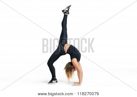 Young Woman Making Bridge Pose Isolated