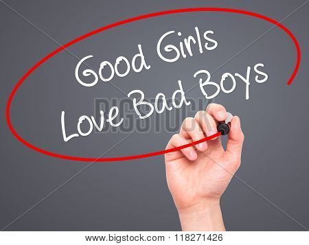 Man Hand Writing Good Girls Love Bad Boys With Black Marker On Visual Screen