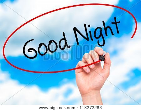 Man Hand Writing Good Night  With Black Marker On Visual Screen