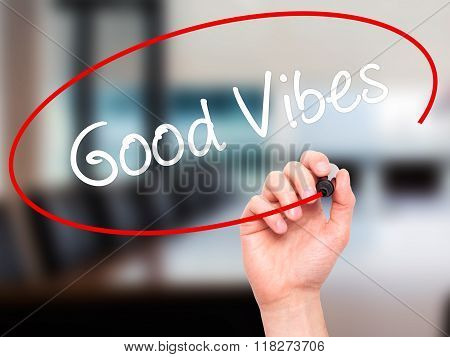 Man Hand Writing Good Vibes With Black Marker On Visual Screen