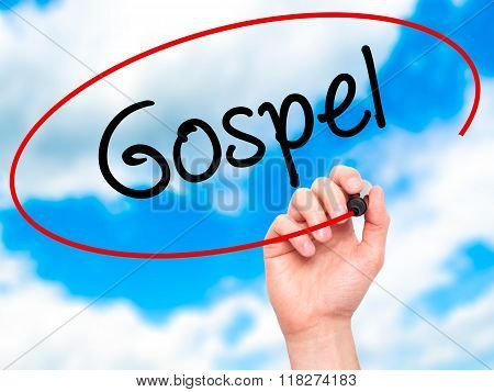 Man Hand Writing Gospel  With Black Marker On Visual Screen