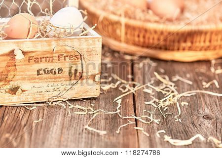 Eggs In A Wooden Egg Box On Table