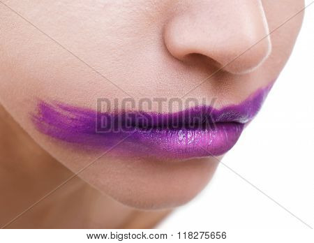 Woman's face with smeared purple lipstick isolated on white, close up