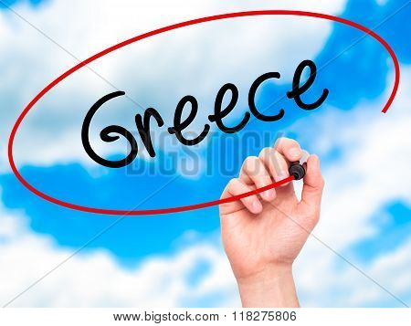 Man Hand Writing Greece  With Black Marker On Visual Screen