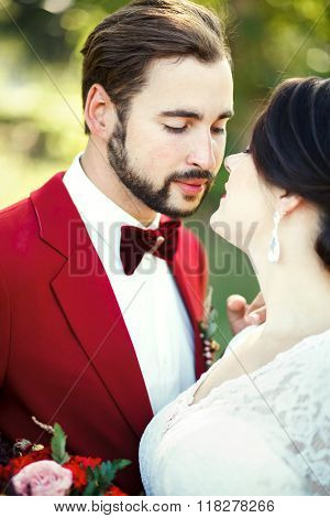 The bride and groom closeup, before kiss, outdoor, tenderness, passion. Wedding style Marsala, verti