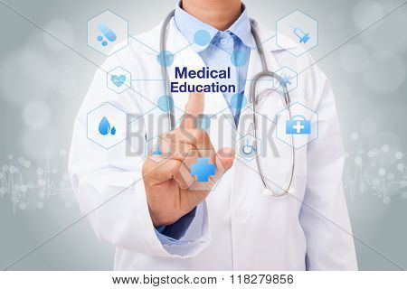 Doctor hand touching medical education sign on virtual screen. medical concept