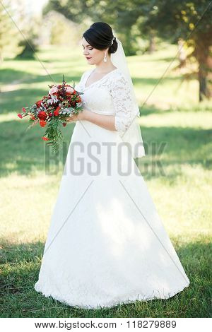 Bride on a background of trees, Fine portrait, full-length.