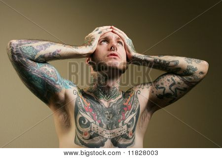 Troubled man with tattoos