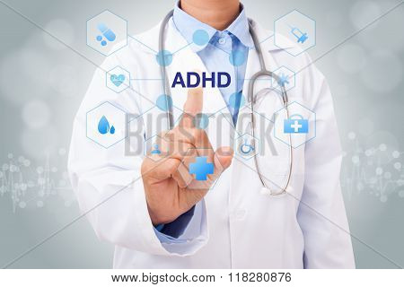 Doctor hand touching ADHD sign on virtual screen. medical concept