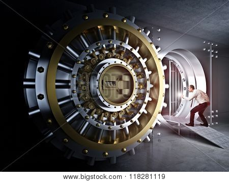 man with flashlight and vault bank door