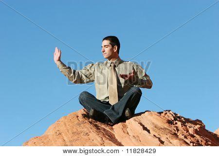 Young businessman doing yoga