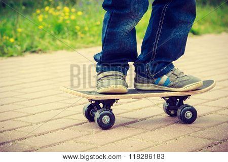Skateboarder Legs Closeup. Kid Skateboarding.