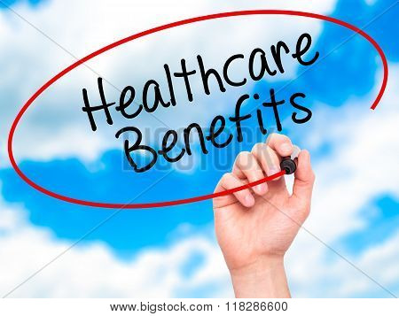 Man Hand Writing Healthcare Benefits With Black Marker On Visual Screen