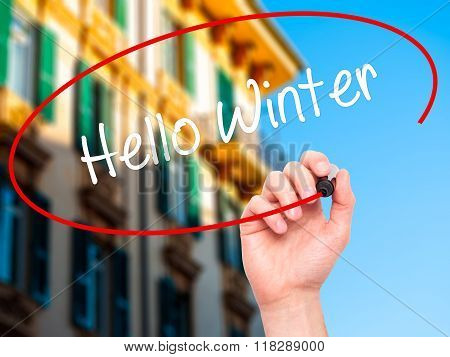 Man Hand Writing Hello Winter With Black Marker On Visual Screen