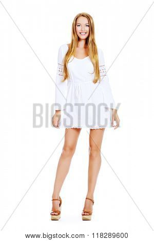 Attractive young woman in a white summer dress and sandals. Isolated over white.