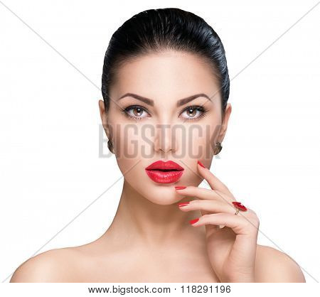 Beautiful Fashion woman model face portrait with red lipstick and red nails. Glamour girl with bright makeup isolated on white. Beauty female. Perfect skin and make up. Red lips and nail polish