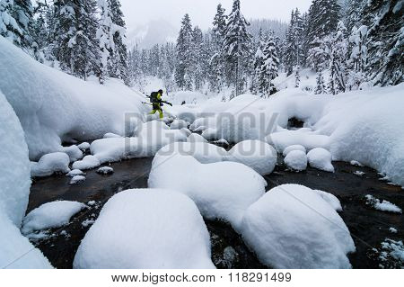 Skier Crossing The River