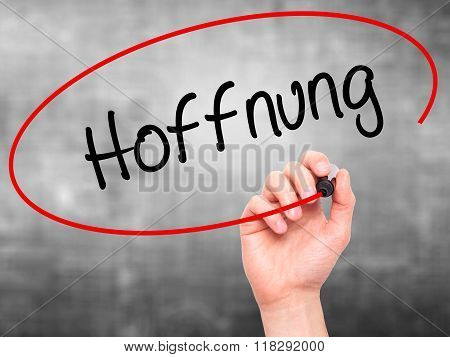 Man Hand Writing Hoffnung (hope In German)   With Black Marker On Visual Screen