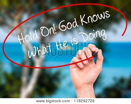 Man Hand Writing Hold On! God Knows What He Is Doing With Black Marker On Visual Screen
