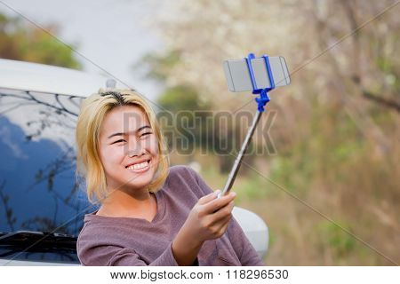 Happiness Girl Holding Selfie Stick Taking Photo On Road Beside