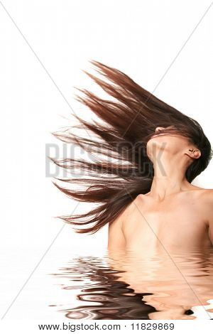 Sexy nude woman flipping her hair backwards