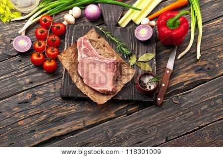 Juicy Piece Of Meat On The Bone With Vegetables