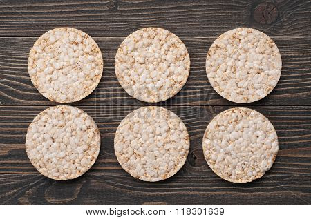 Dietary Round Rice Cakes On A Dark Wooden Background