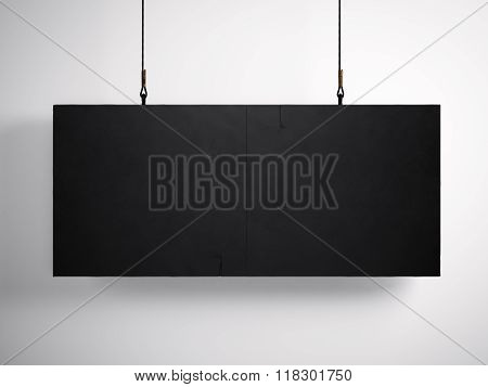Photo of blank black canvas hanging on the white background.  3d render