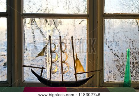 Model Of A Ship On Frosted Window In The Morning