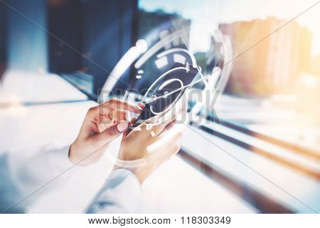 Girl touching a screen of her smarthone. Blurred background, horizontal, visual effects