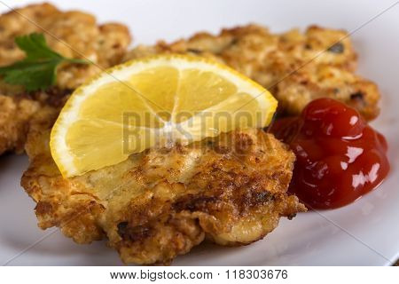 Escalope Or Schnitzel With Ketchup Or Tomato Sauce And Lemon