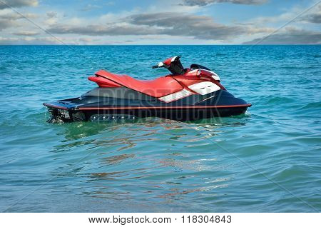 Jet-ski On Waves Of The Sea Against The Blue Sky