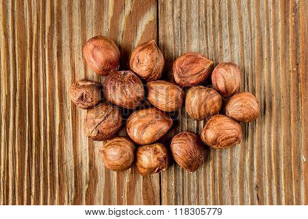 Heap of hazelnuts on a wooden table