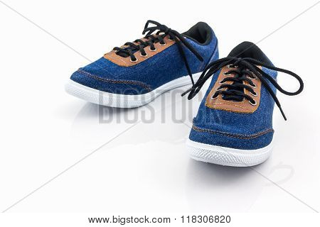 Blue Sneakers On A White Background.