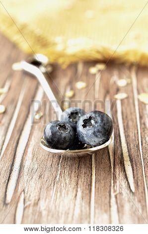 Blueberries on a teaspoon, selective focus