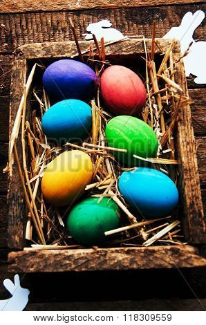 Easter Composition with chicken Eggs on the Warm Wooden Background. Easter composition with fresh eg