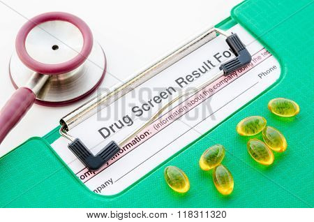 Drugs And Drug Screen Result Form In File With Stethoscope.