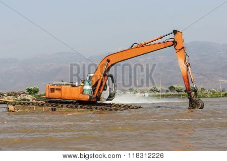 Big Water Excavator Dredging Sediment Mud From River