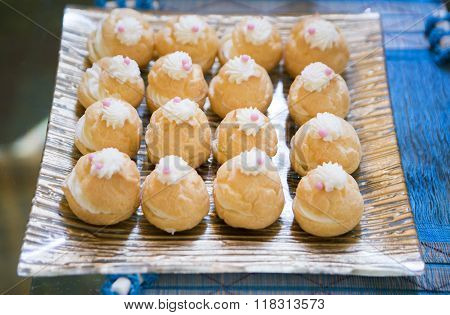 Choux Cream In Bakery Tray On Wood Dish.