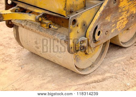 working with little vibrating roller in construction site
