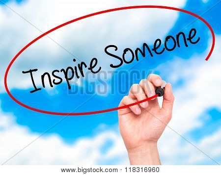 Man Hand Writing Inspire Someone  With Black Marker On Visual Screen