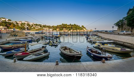 Fishing boats pier at calm summer evening