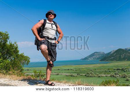Happy tourist hiking at Skadar lake