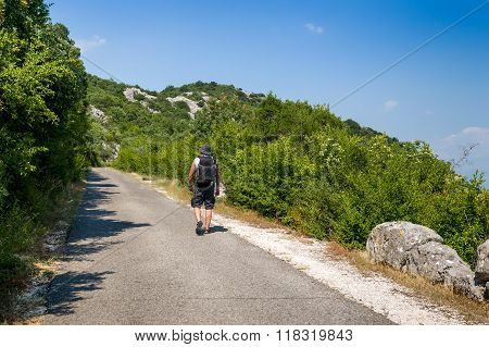 Treveller going up the hill in Montenegro.