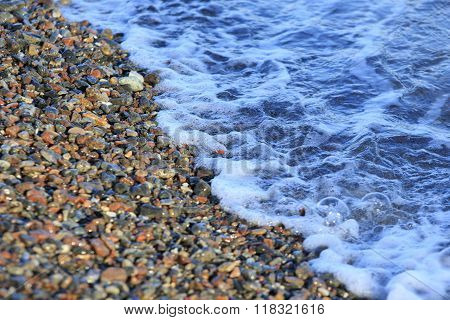 Pebbles And Sea Surf